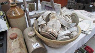 A large lot of stoneware bottles, pot lids etc.