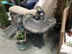 A garden bird bath and an a/f rabbit planter.