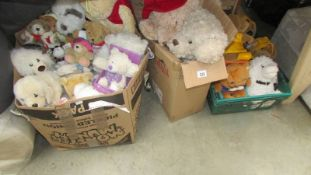 Three large boxes of assorted soft toys.