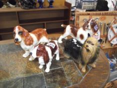 4 china dogs, 3 spaniels and a Yorkshire Terrier by Cooper Craft etc.