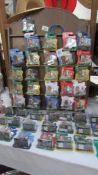 A large collection of new and mint carded soccer start figures including Everton, Fulham, Brazil,