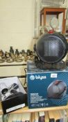 A Blyss ceramic heater and a hair dryer.