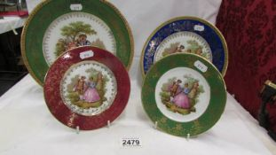 Two large Limoges cabinet plates and 2 smaller examples.