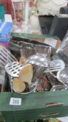 A box of stainless steel kitchen ware.