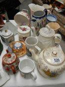 A mixed lot of china teapots etc.