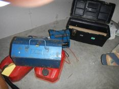 Three fuel cans, battery charger and tool box.
