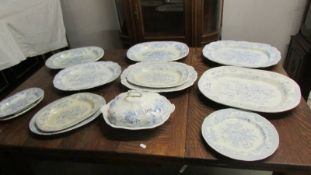 A quantity of blue and white meat platters and a tureen.