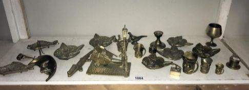 A selection of brassware including cat head, dishes & crocodile nut cracker etc.