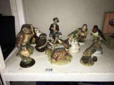 6 bird figures including owls, a red deer,