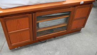 A good teak TV stand and a video.