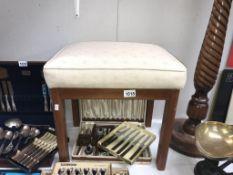 A bedroom stool.