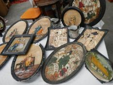 Eleven Bretby wall plaques including Japanese scenes,