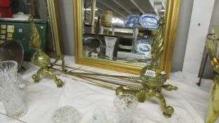 A pair of heavy brass Victorian fire dogs together with a set of 3 brass fire irons, (shovel,
