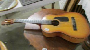 An acoustic guitar,