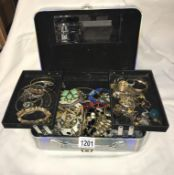A silver jewellery box with an assortment of costume jewellery