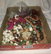 A box of beaded costume jewellery