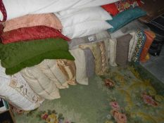 Approximately 28 clean cushions.