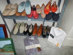 Two shelved of used shoes.