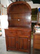 A domed top oak dresser.
