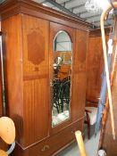 A mahogany inlaid single mirrored door wardrobe.