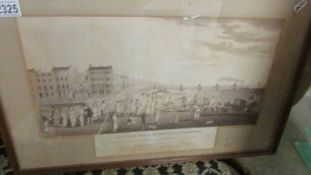 A 19th century framed and glazed engraving entitled 'The Chain Pier at Brighton with Characters'.