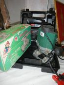 A boxed jig saw, router and sander.