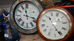 Two good modern wall clocks.