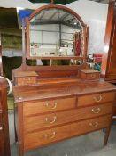 A mahogany mirror backed dressing table.