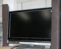 A JVC TV and a pair of speakers.