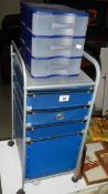 A modern filing chest on castors and a three drawer plastic chest.