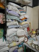 A large quantity of pillows in pillowcases.