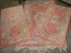 Three Chinese rugs.