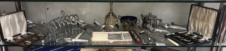 A good selection of plated flatware/cutlery sets etc.