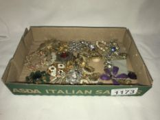 A mixed lot of brooches & earrings