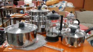 A quantity of clean kitchen pans.
