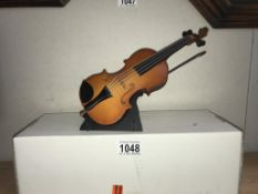 A musical double bass on stand - length approximately 25cm