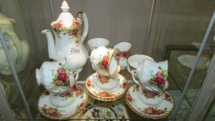 A Royal Albert Old Country Roses coffee set and small urn.