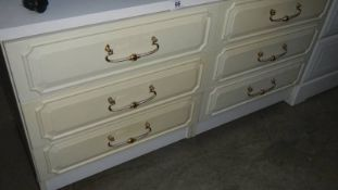 A white 6 drawer bedroom chest.