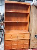 A teak effect open rack dresser.