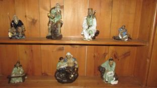 Seven ceramic Chinese figures.