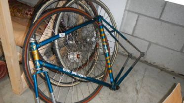 A Bob Johnson cycle frame and 4 good cycle wheels.