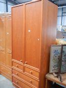 A teak 2 door wardrobe with 4 drawers.