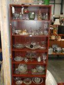 Seven shelves of glass ware.