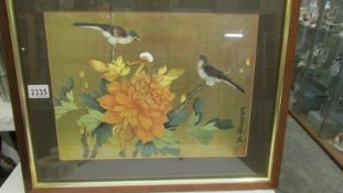 A framed and glazed Chinese/Japanese painting of birds, signed.