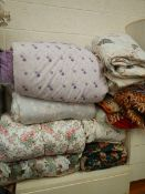 A quantity of quilts and bedcovers (collect only)