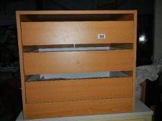 A three drawer chest.