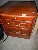 A mahogany 2 drawer chest.
