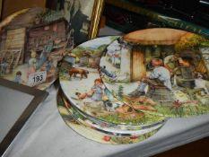 Twelve Royal Doulton collector's plates.