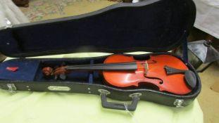 A small cased violin.