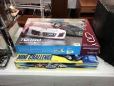 2 micro Scalextric sets,
